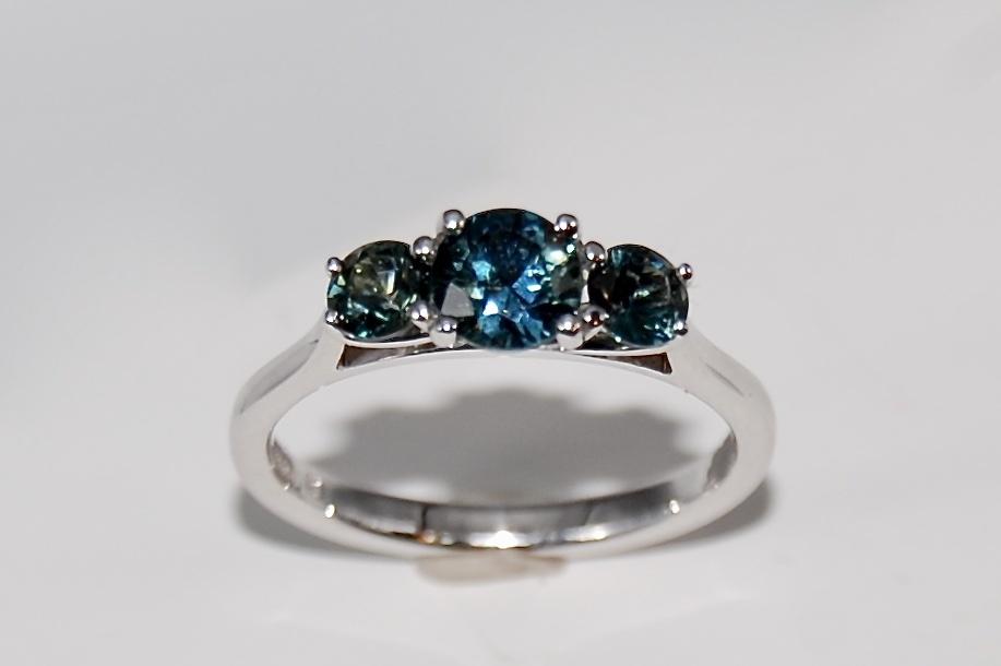 Teal Sapphire three stone