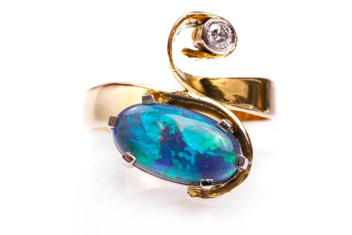 Natural black opal and diamond ring
